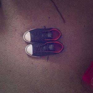 Converse All Star tennis shoes.